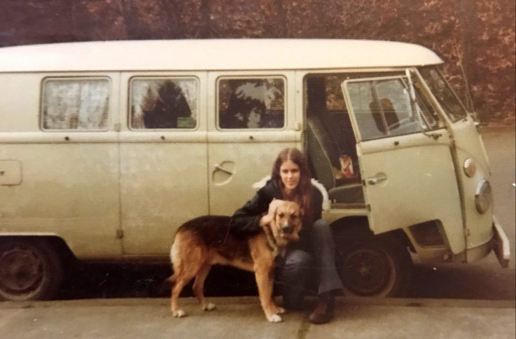 Young Monica With Her Dog In Front Of A Van